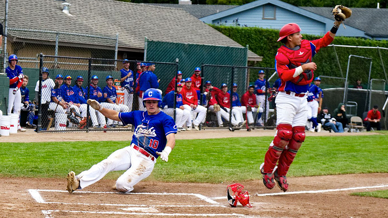 Dawson Bacho slides home ahead of the tag.