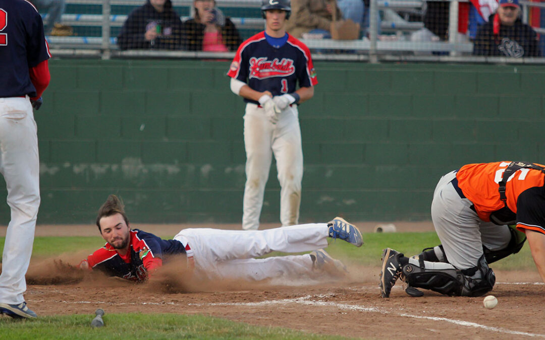 Aaron Casillas slides safely into home against the Bay Area Force.